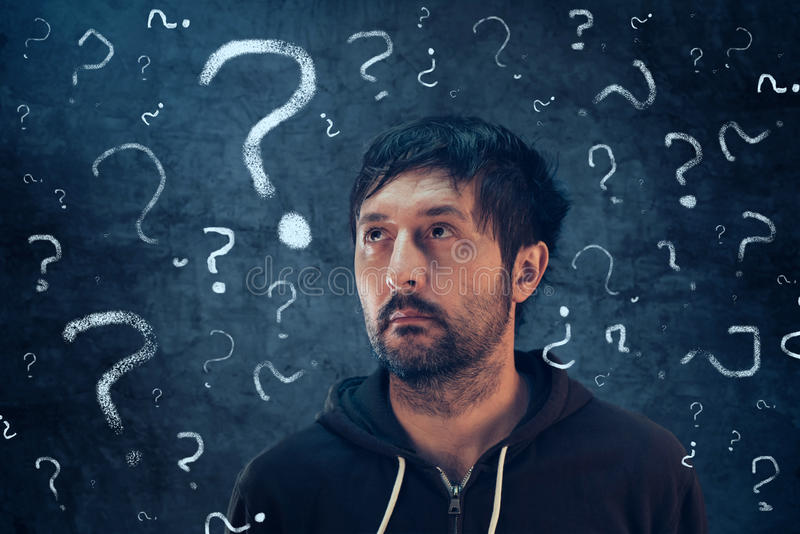 Confused man with so many questions. Looking for the answer to his problems royalty free stock images