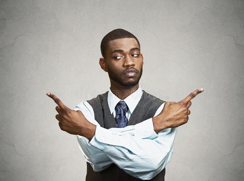 Download Confused Man Pointing In Two Different Directions Stock Image