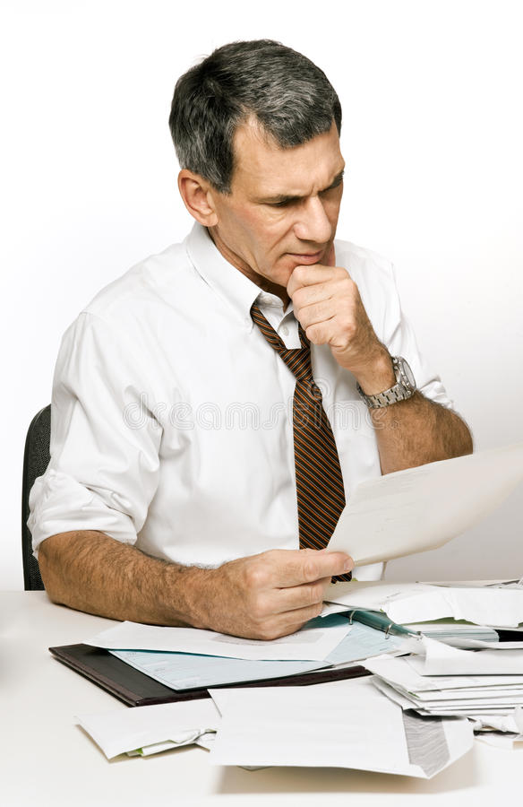 Confused Man Reading A Bill Or Bank Statement Stock Photos