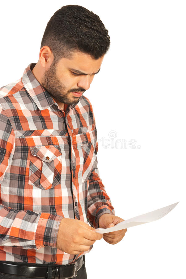Confused man reading paper royalty free stock photos