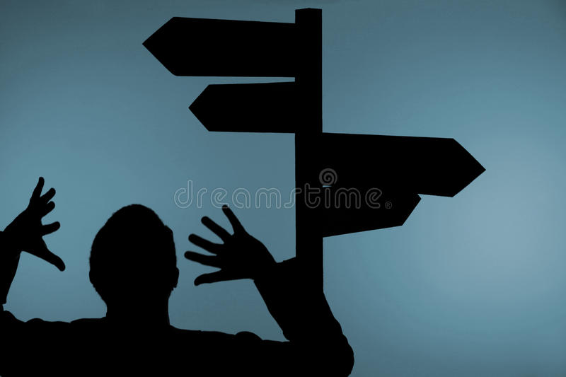 Confused Man And Signpost Stock Image