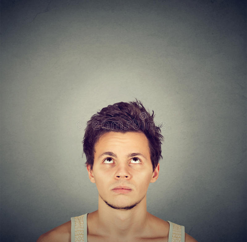 Confused man thinking looking up copy space above head stock photos