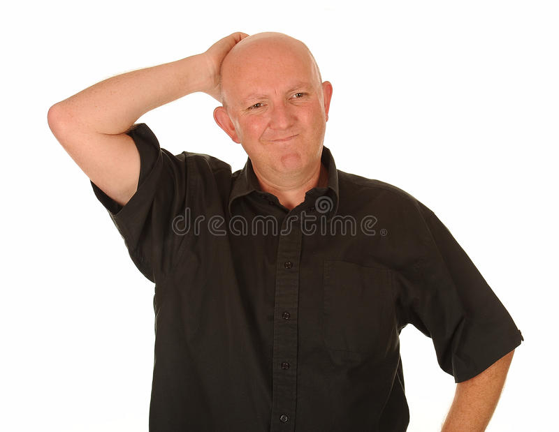 Confused middle aged man. Half body portrait of confused middle aged man scratching head, white background royalty free stock photo