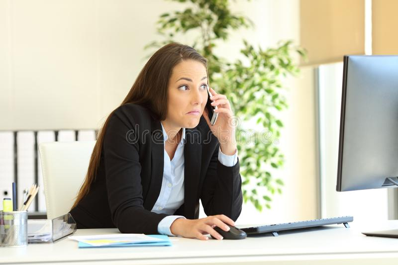 Confused office worker calling on phone royalty free stock photo