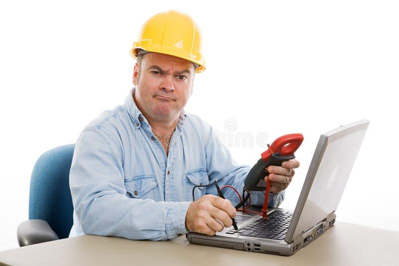 confused repairman arkivfoto