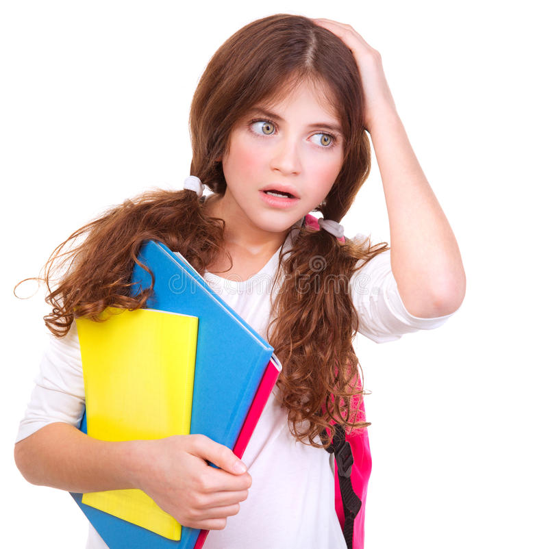 Confused school girl. Portrait of confused school girl holding head by hand isolated on white background, didn't know answer on question, difficult test concept royalty free stock photo