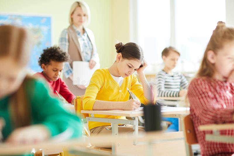 Confused schoolgirl having problem with quiz stock photos