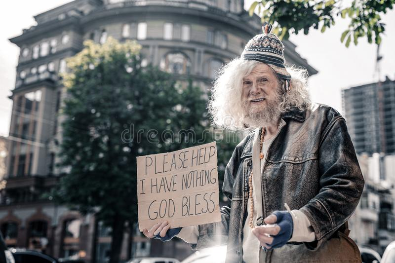 Confused senior homeless man being dirty and washed royalty free stock images