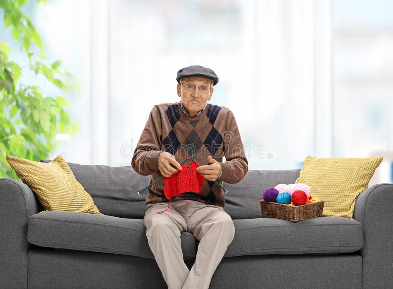 Confused senior knitting royalty free stock images
