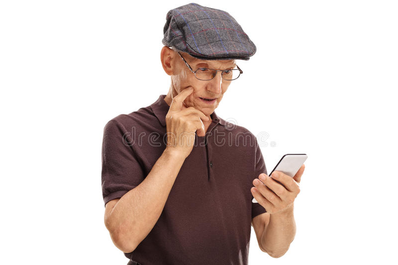 Confused senior looking at a cell phone stock photography