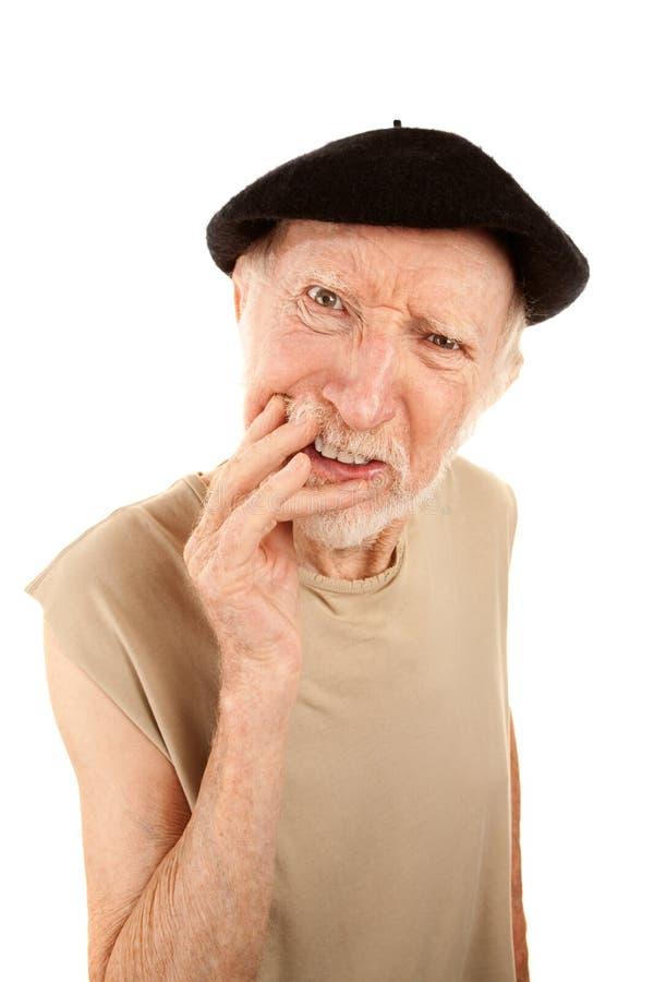 Confused senior man in beret stock photos