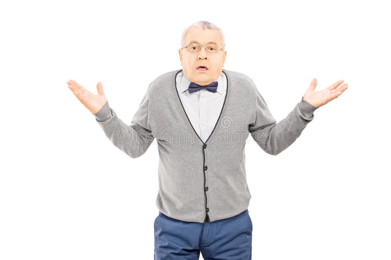 Confused senior man gesturing with hands isolated on white background royalty free stock photos