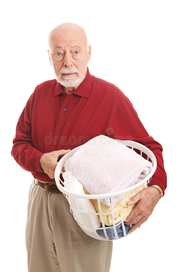 Confused Senior Man with Laundry royalty free stock photography