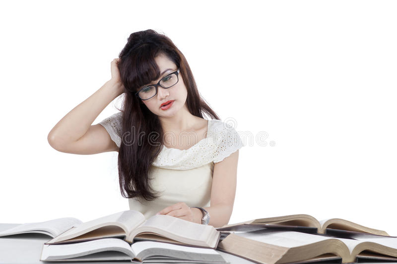 Confused student reading many books 2 royalty free stock photo