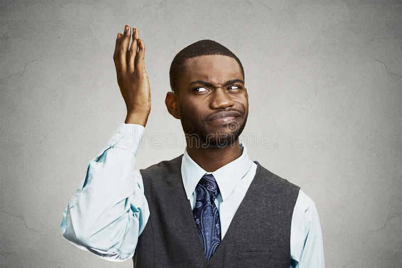 Confused, unhappy young businessman stock photo