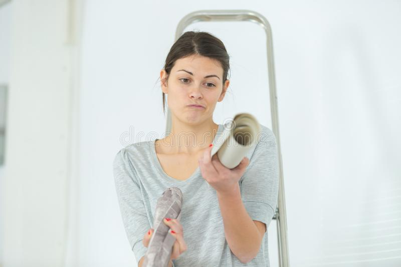 Confused woman while doing diy royalty free stock image