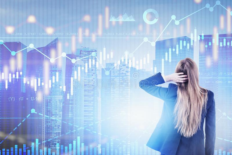 Confused woman looking at forex graphs in city royalty free stock image