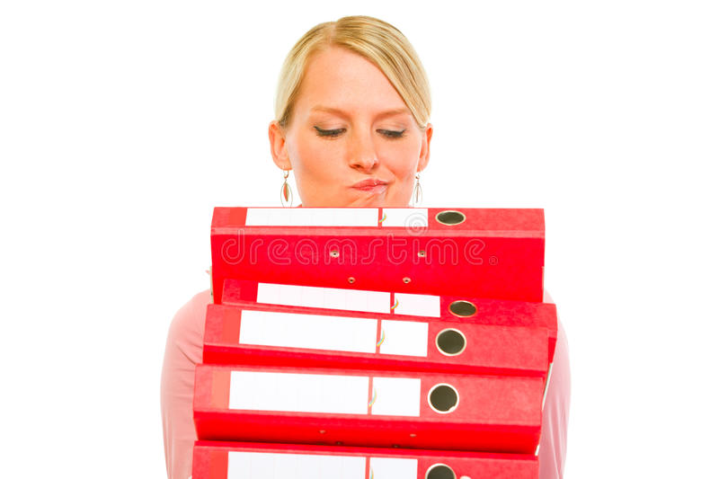 Confused woman with pile of folders. Isolated on white royalty free stock images
