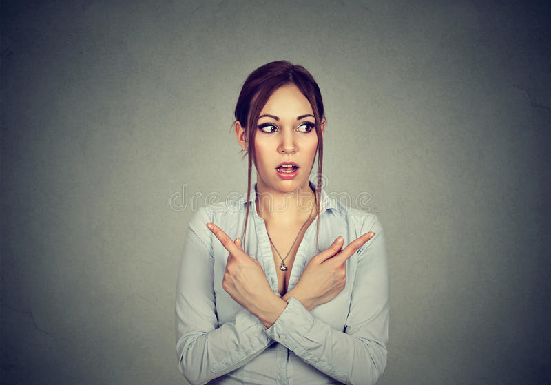 Download Confused Woman Pointing In Two Different Directions Not Sure Which Way To Go Stock Photo