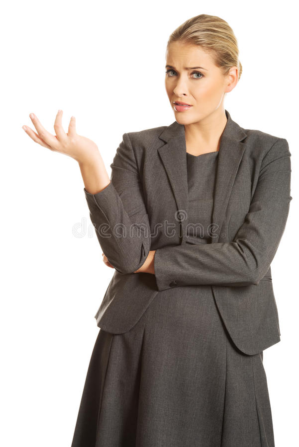 Confused woman showing irritate gesture royalty free stock photos