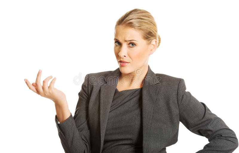 Confused woman showing irritate gesture royalty free stock photo