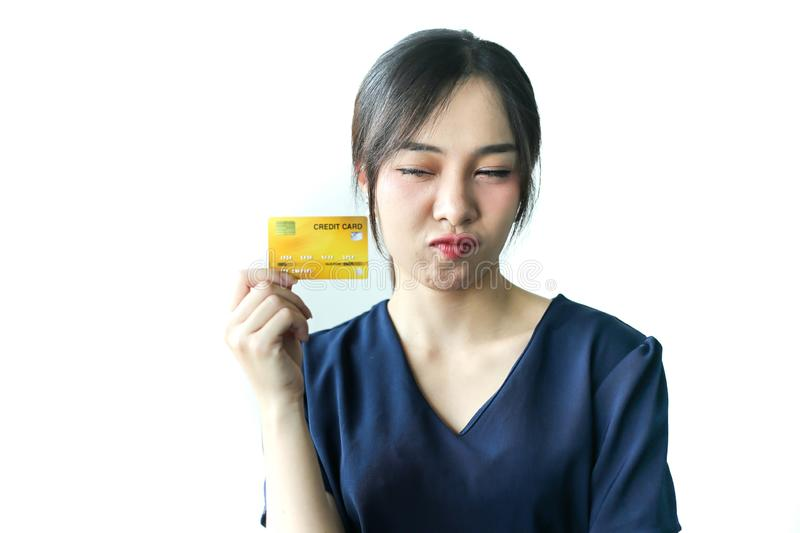 Confused young asia woman having problem with blocked credit card  invalid expired account, transaction failed, money withdraw royalty free stock photo