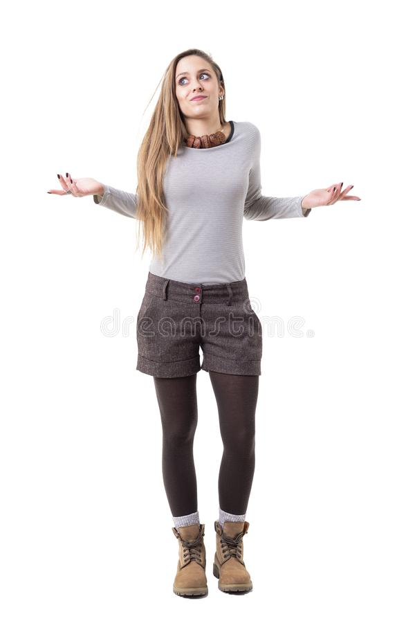 Confused young cute long hair blonde shrugging shoulders and looking up. stock photography