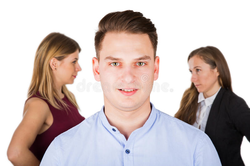 Confused young man with jealous women royalty free stock photography
