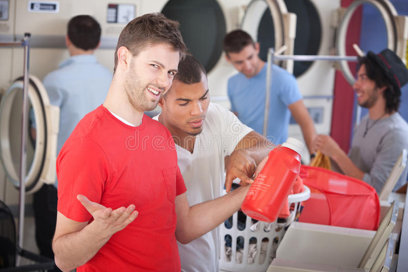 Confused Young Man in Laundromat stock photography