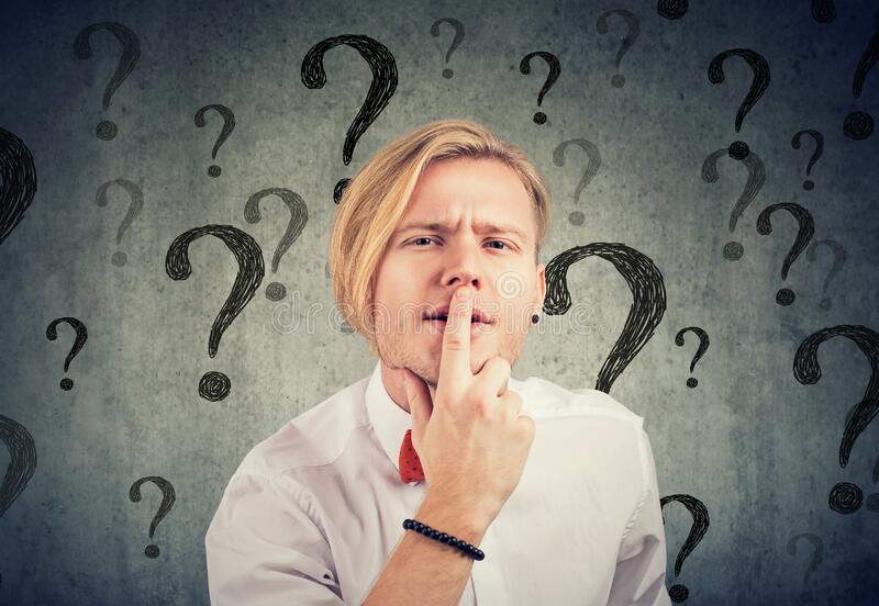 Confused man with too many questions and no answer stock photos