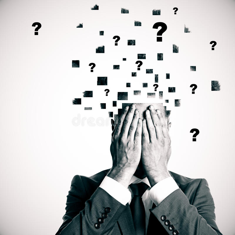 Confusion concept. Businessman with broken into pieces head and abstract question marks on light background. Confusion concept stock photo