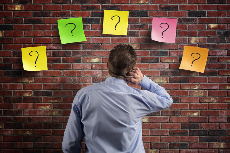 Confusion and question marks stock images
