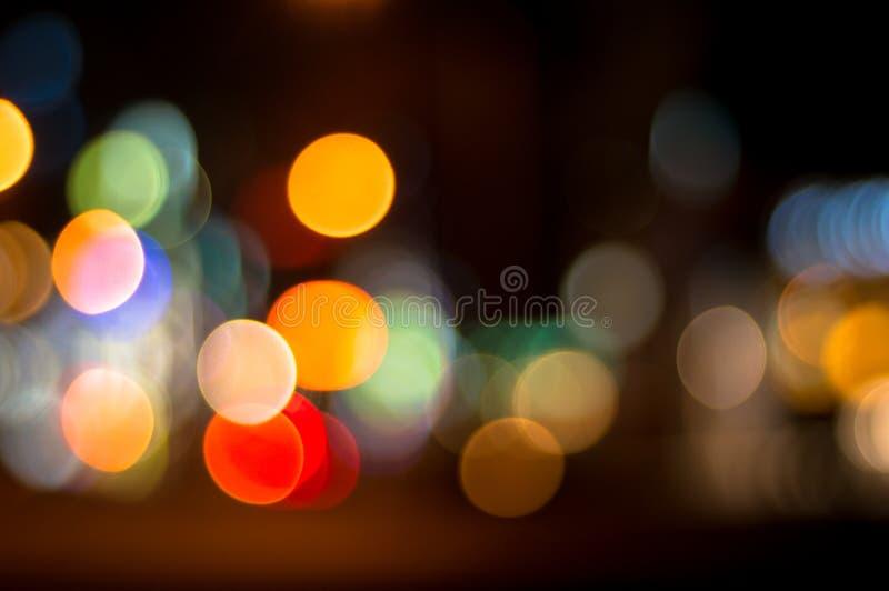 Confuso, defocused, luci della città del bokeh fotografia stock libera da diritti