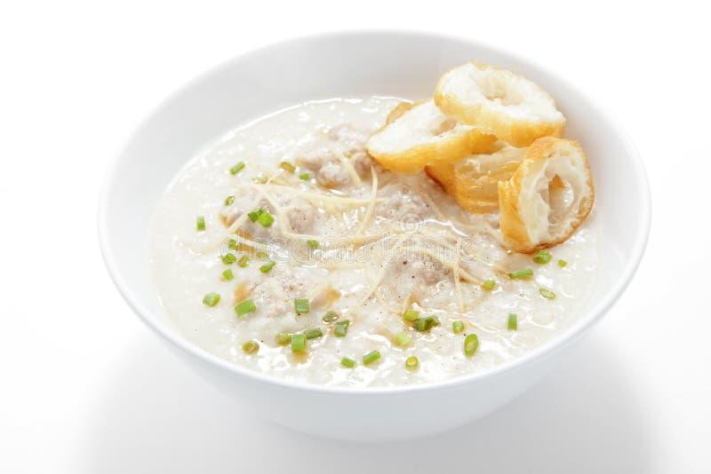 Congee della carne di maiale con doughstick fritto nel grasso bollente fetta fotografia stock libera da diritti