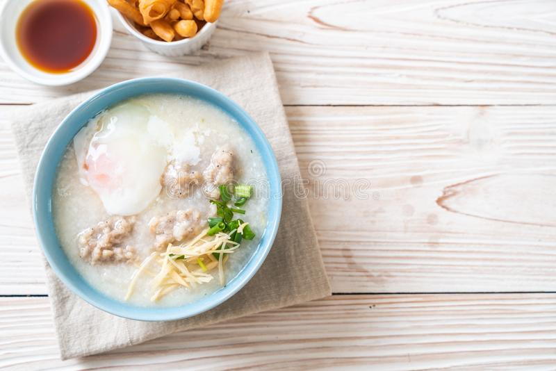 congee with minced pork in bowl stock image