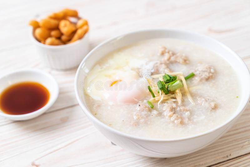 congee with minced pork in bowl stock images
