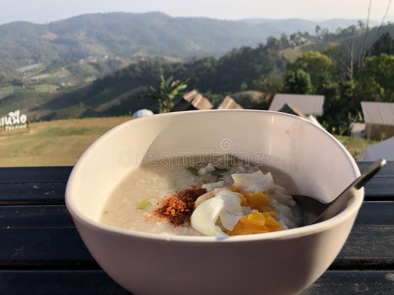 Congee with minced pork in bowl - Asian breakfast style royalty free stock images