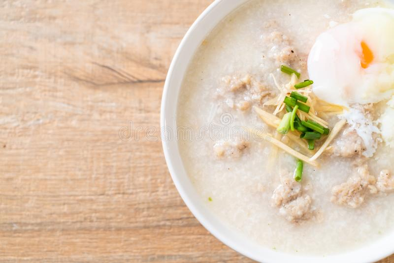congee with minced pork in bowl stock photography