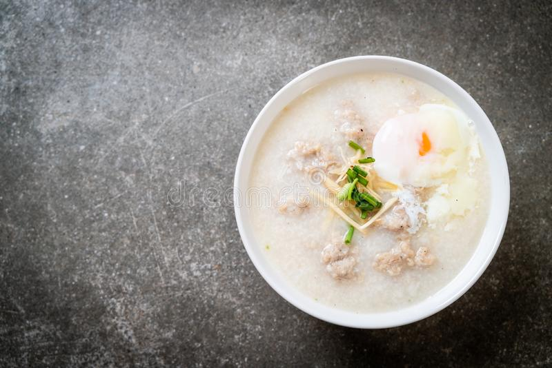 congee with minced pork in bowl stock photo