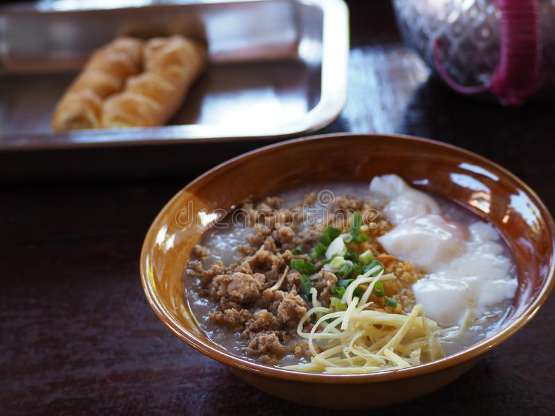Congee with minced pork and egg in bowl royalty free stock photos