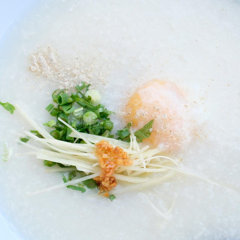 Congee with pork and boiled egg stock photography
