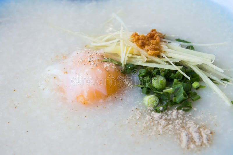 Congee with pork and boiled egg royalty free stock photography