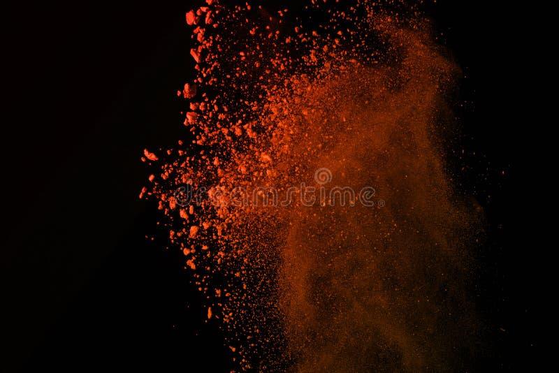 Congele el movimiento de las explosiones coloreadas del polvo aisladas en el CCB negro imagen de archivo libre de regalías
