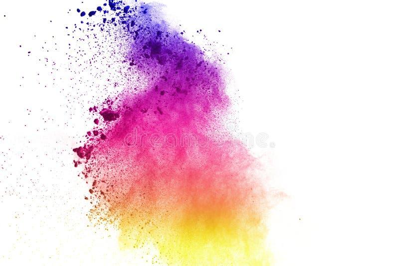 Congele el movimiento de las explosiones coloreadas del polvo aisladas en el fondo blanco fotos de archivo