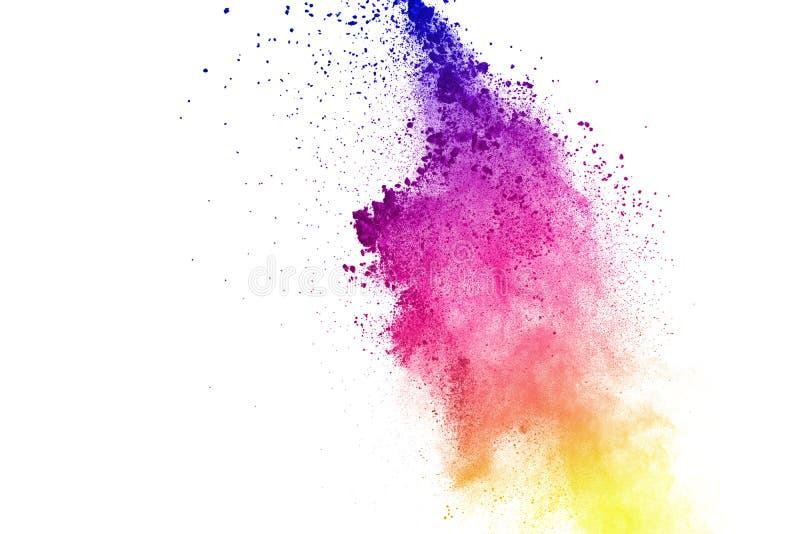 Congele el movimiento de las explosiones coloreadas del polvo aisladas en el fondo blanco foto de archivo