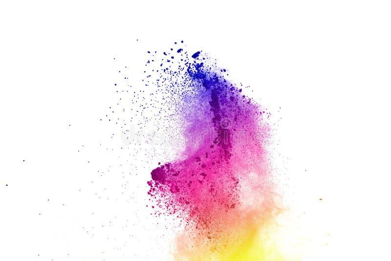 Congele el movimiento de las explosiones coloreadas del polvo aisladas en el fondo blanco fotografía de archivo