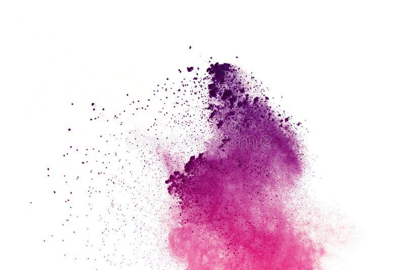 Congele el movimiento de las explosiones coloreadas del polvo aisladas en el fondo blanco imagen de archivo libre de regalías