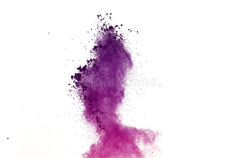 Congele el movimiento de las explosiones coloreadas del polvo aisladas en el fondo blanco fotografía de archivo libre de regalías
