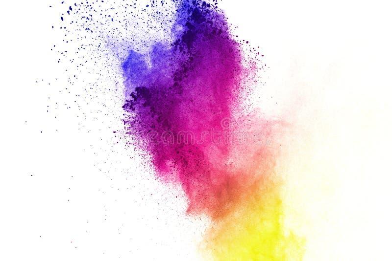 Congele el movimiento de las explosiones coloreadas del polvo aisladas en el fondo blanco imagen de archivo