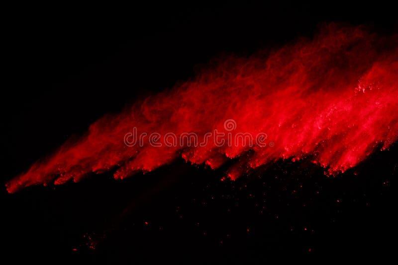 Congele o movimento da explosão colorida do pó isolada no fundo preto Sumário da poeira multicolorido splatted foto de stock royalty free